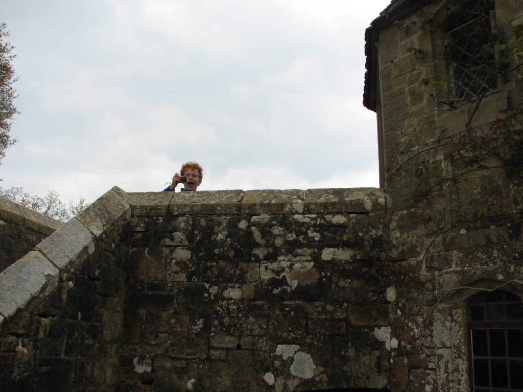 Boy over old stone wall